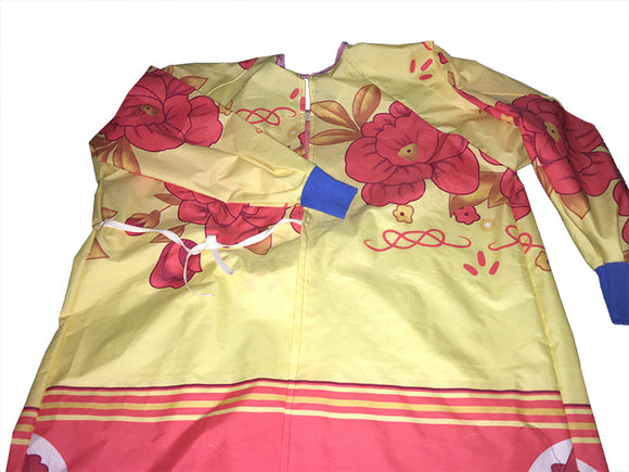 Finished product hospital gown on white background (zip up hospital gown in beige colour with pink and gold large floral pattern above and thick solid pink on bottom of gown, bright blue fabric wrists)