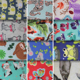 Group swatch animals printed fleece fabrics in various colours and styles