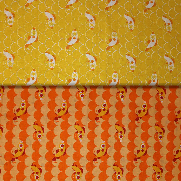 Group swatch cartoon fish and scales printed fabric in yellow and orange