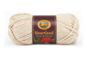 A ball of Lion Brand Heartland Thick & Quick in colourway Joshua Tree (heathered olive)