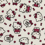 "Square swatch Hello Kitty printed fabric white fabric with tossed pink bows, kitty heads, full character, apples, and ""Hello Kitty"" speech bubbles"