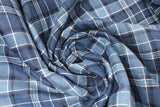Swirled swatch blue plaid fabric (pale medium/dark blue plaid with white and black plaid lines in addition to multi blue hues)