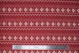 Flat swatch red winter pattern fabric (red fabric with white Christmas sweater style pattern stripes with pixelated triangle design and quilt like floral repeated)