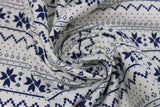 Swirled swatch white winter pattern fabric (white fabric with navy Christmas sweater style pattern stripes with pixelated triangle design and quilt like floral repeated)