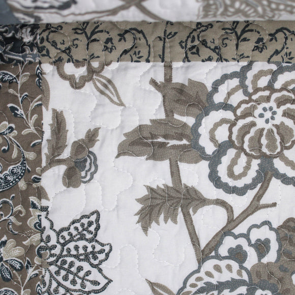 Swatch of matelasse printed fabric (grey floral)