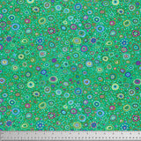 Swatch of multi-coloured Roman glass printed fabric in emerald