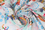 Swirled swatch white fabric with blue shadow floral and colourful flowers and giraffes, butterflies, high heeled shoes, printed fabric