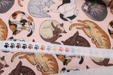 Raw hem swatch cat themed fabric in cat nap (light pink fabric with assorted cartoon napping cats allover)