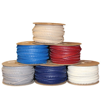 Small rolls of vinyl piping stacked in pyramid form (Bottom Row: Grey, Navy, White, Middle Row: Blue, Red, Top Row: Beige)