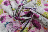 Swirled swatch of butterfly/floral printed fabric