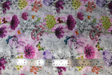 Flat swatch of butterfly/floral printed fabric