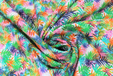 Swirled swatch Borabora fabric (white fabric with heavily layered tropical style leaves in black, green, blue, pink, orange ranging in levels of transparency)