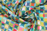 Swirled swatch Caleido fabric (geometric collage look pattern fabric circles allover with diamonds within all in lime green, green, teal, pink, blue, orange colourway)