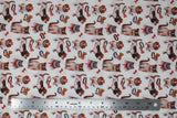 Flat swatch bows fabric (white fabric with tossed dogs and cats in brown, white and grey with red and bronze bows and collars tossed)