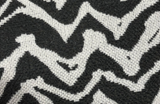 Square swatch upholstery fabric with zebra like print in smoke grey (white with dark grey stripes/pattern)