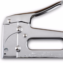 Slightly cropped image of a silver staple gun, trigger arching up and to the right above the rounded grip.  Some faint, illegible text is etched into the bottom edge of the handle.