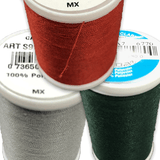 A closeup of thread spools in red, grey and green