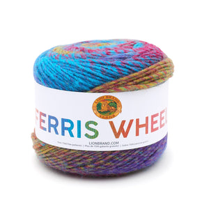 A cake of Lion Brand Ferris Wheel in colourway Vintage Carousel (twisted strands of peacock blue, magenta, gold, and violet)