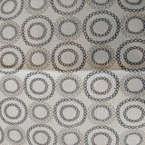 Square swatch upholstery fabric with circles (within circles) print in white/black/grey shades