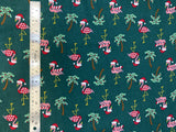 Flat swatch winter themed flannel in Christmas flamingo (sweater/scarf and santa hat wearing flamingos with decorated palm trees on dark green)
