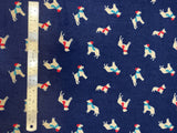 Flat swatch winter themed flannel in Winter dogs (white dogs with red and blue scarves and hats on dark blue)