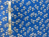 Flat swatch winter themed flannel in Winter fox (grey cartoon foxes with hats on medium blue)