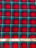 Flat swatch winter themed flannel in Christmas flannel (red/green/blue/white plaid squares)