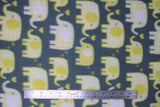 Flat swatch yellow elephants fabric (dark pale blue fabric with white and yellow cartoon rounded look elephants in various sizes trunks faced to each other with tossed yellow hearts)