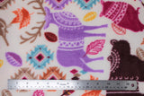 Flat swatch patterned forest animals fabric (white fabric with colourful deer, bears, owls, birds, with lines of tribal/mandala style pattern within. Tossed leaves and small patterned patches. All in a purple, brown, burgundy, orange, yellow, pink, red, blue colourway)