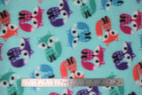 Flat swatch colourful foxes fabric (light blue fabric with medium sized cartoon foxes tossed in purple, dark pink, orange, blue, and teal colours)