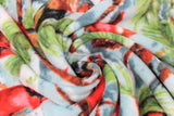Swirled swatch spruce cardinal fabric (light blue/white sky look fabric with green and brown spruce tree branches holding red cardinals, red berries, and pinecones)