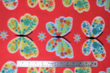 Flat swatch butterflies fabric (bright medium bubblegum pink fabric with large white, blue, and yellow butterflies with lines of colourful floral pattern within wings, tossed daisy look flowers)