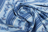 Swirled swatch winter printed fabric in Pinecone Stripes on Light Blue