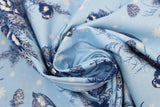 Swirled swatch winter printed fabric in Swallows & Pinecones on Light Blue