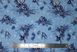 Flat swatch winter printed fabric in Swallows & Pinecones on Light Blue