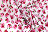 Swirled swatch garden themed printed fabric in Pink Flowers & Green Leaves on White