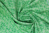 Swirled swatch garden themed printed fabric in Green Leaves on Light Green
