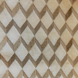 Swatch of Brent upholstery fabric - velvet texture in a geometric diamond print - in colourway Tan (ivory base with gold zigzag)