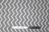 Flat swatch calico fabric in grey and white zigzag (chevron)