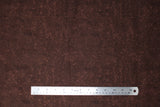Flat swatch calico fabric in brown