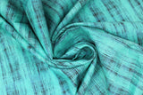 Swirled swatch calico fabric in teal & black blended