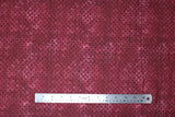Flat swatch calico fabric in burgundy dots on burgundy