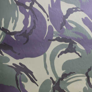 Swatch of camouflage printed smooth vinyl fabric