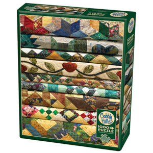 Cobble Hill 1000pc puzzle Grandma's Quilts - a stack of nine quilts in various classic quilt patterns and rustic colours from bright to light shades.