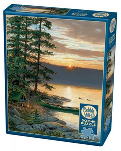 Group photo assorted 500-piece Cobble Hill puzzles in packaging