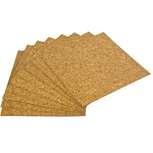 A fan of square cork sheets on a white background