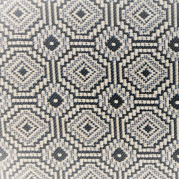 Jacquard upholstery fabric arranged in a geometric pattern - tiled concentric octagons and concentric squares in navy, cream and light blue