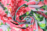 Swirled swatch berkshire garden fabric (pale grey/blue fabric with subtle stripe and large tossed pink and red floral bouquets with greenery allover)