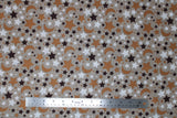 Flat swatch small stars and moons printed fabric in black