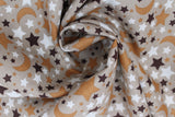 Swirled swatch small stars and moons printed fabric in black